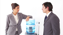Colleagues chatting next to the water cooler Stock Video Footage