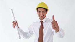 Smiling engineer holding blueprints Stock Video Footage