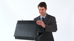 Smiling man opening his briefcase Footage