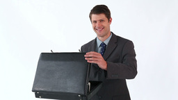 Smiling man opening his briefcase Stock Video Footage