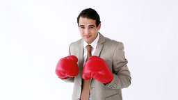 Businessman boxing with red gloves Stock Video Footage
