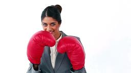 Smiling secretary using boxing gloves Footage