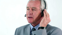 Mature businessman using a headset Footage