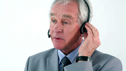 Mature businessman using a headset Stock Video Footage