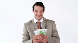 Smiling businessman holding a fan of notes Stock Video Footage