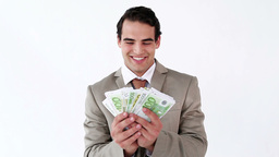 Smiling businessman holding a fan of notes Footage
