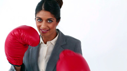 Smiling executive using red boxing gloves Footage