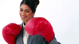 Smiling executive using red boxing gloves Stock Video Footage