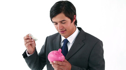 Smiling businessman holding a piggy bank Stock Video Footage