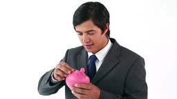 Smiling businessman holding a piggy bank Footage