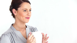 Welldressed woman drinking coffee Footage