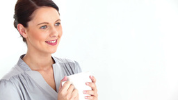 Welldressed woman drinking coffee Stock Video Footage