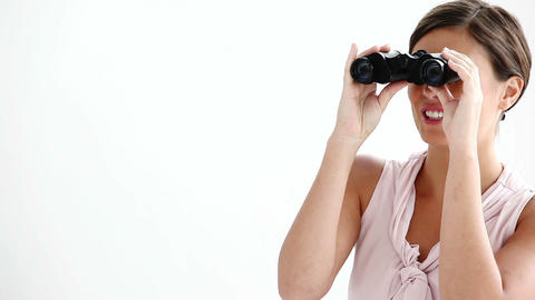 Welldressed woman looking through binoculars Footage