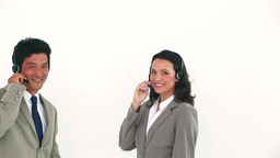 Two business people posing with headsets Stock Video Footage