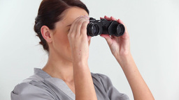 Beautiful woman looking through binoculars Stock Video Footage
