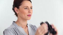 Beautiful woman looking through binoculars Footage