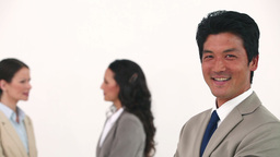 Businessman laughing in front of his colleagues Footage