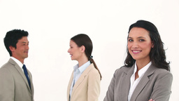 Young businesswoman posing while her colleagues are talking Footage