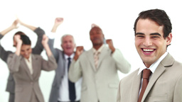 Man laughs while his colleagues are cheering Footage
