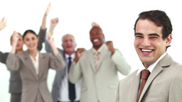 Man laughs while his colleagues are cheering Stock Video Footage
