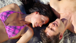 Smiling couple lying together Stock Video Footage