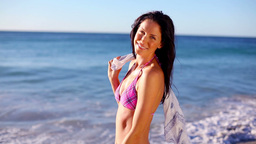 Smiling brunette holding a sarong Footage