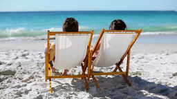Relaxed couple looking out at the sea Stock Video Footage