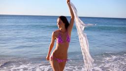 Woman raising her sarong Footage