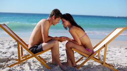 Couple sitting on deck chairs Footage