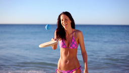 Happy brunette playing with a paddle Footage