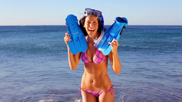 Smiling woman holding her swimming fins Stock Video Footage
