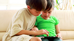 Children playing together with a tablet computer Footage