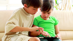 Children playing together with a tablet computer Stock Video Footage