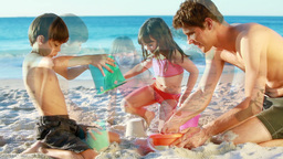 Smiling family building sand castles Footage