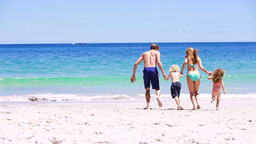 Cheerful family splashing each other Stock Video Footage