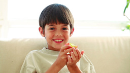 Smiling child eating a red apple Stock Video Footage