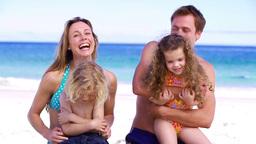 Parents hugging their children Stock Video Footage