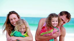 Smiling parents holding their children Stock Video Footage