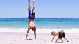Father doing handstands with her son Stock Video Footage