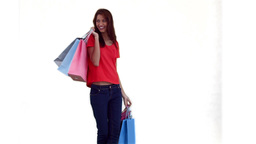 Woman dancing while holding shopping bags Footage