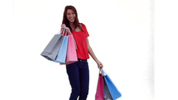 Woman dancing while holding shopping bags Stock Video Footage