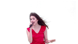 Woman singing while holding a microphone Footage