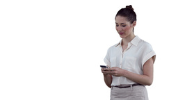 Businesswoman typing a text message before looking Stock Video Footage