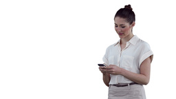 Businesswoman typing a text message before looking Footage