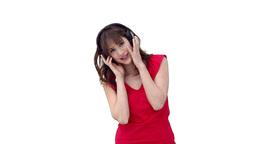 Woman swaying while wearing headphones Footage