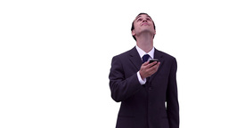 Businessman texting before looking around him Stock Video Footage
