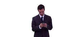 Businessman texting before looking around him Footage