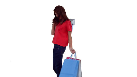 Woman dancing while holding several shopping bags Stock Video Footage