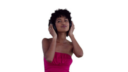 Woman holding her headphones while listening to mu Stock Video Footage