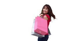 Woman happily holding shopping bags Footage